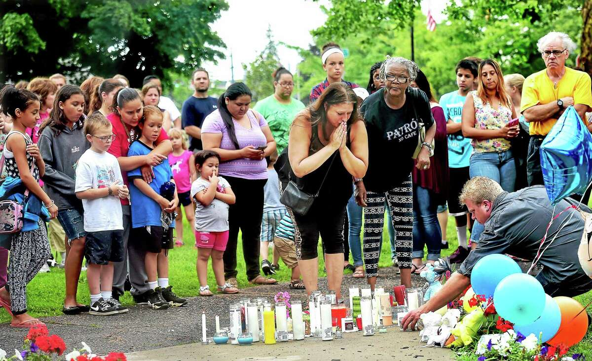 Following the vigil at the South Congregational Church for Aaden Moreno, family, friends and residents walked across the street to the Veterans' Memorial Gazebo on the South Green to pray for the 7-month-old baby boy Wednesday evening.