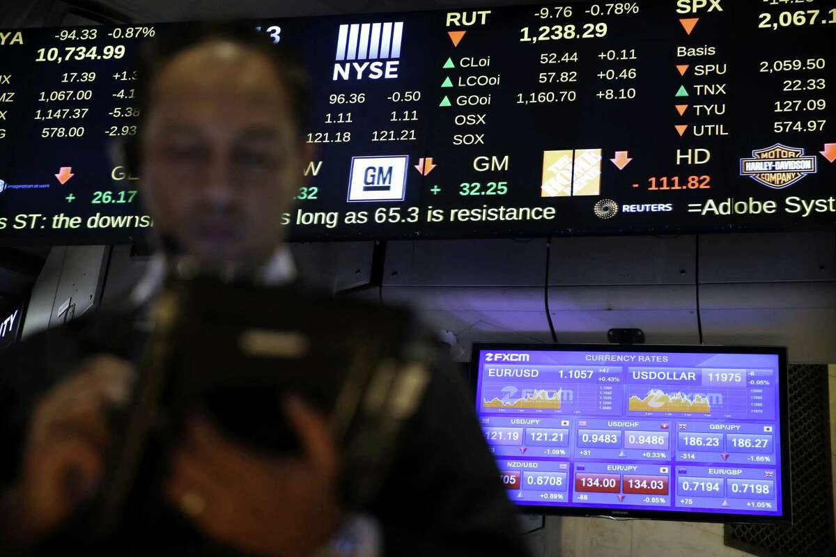Screens display financial information on the floor at the New York Stock Exchange in New York Wednesday.