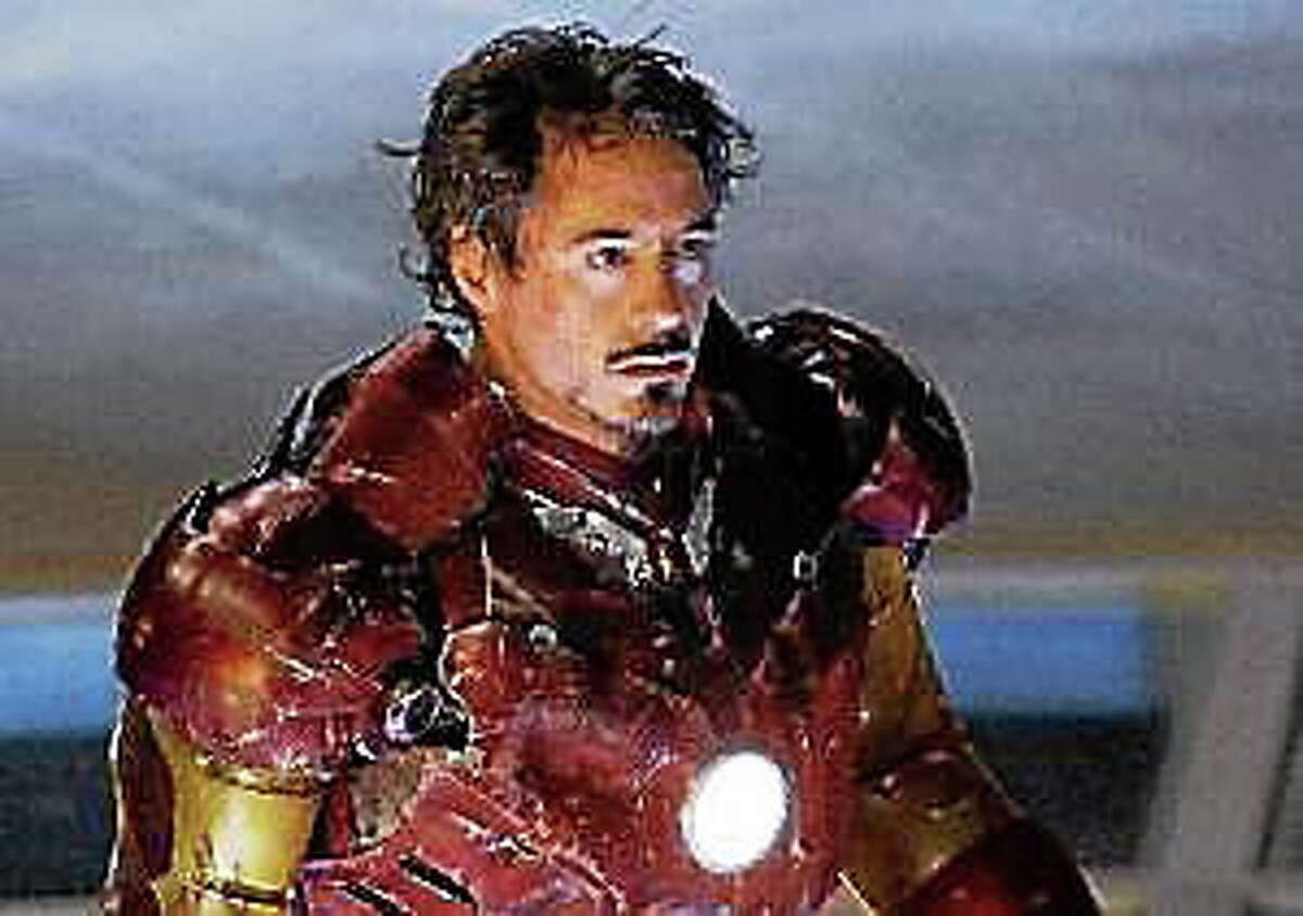 """Billionaire Tony Stark (Robert Downey Jr.) takes to his new outfit in """"Iron Man."""""""