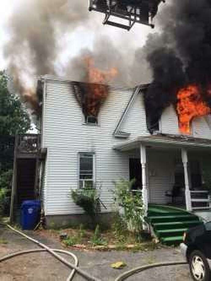 Firefighters extinguished a fire at a Fair Street residence around 12:17 p.m. Saturday Photo: Norwalk Fire Department