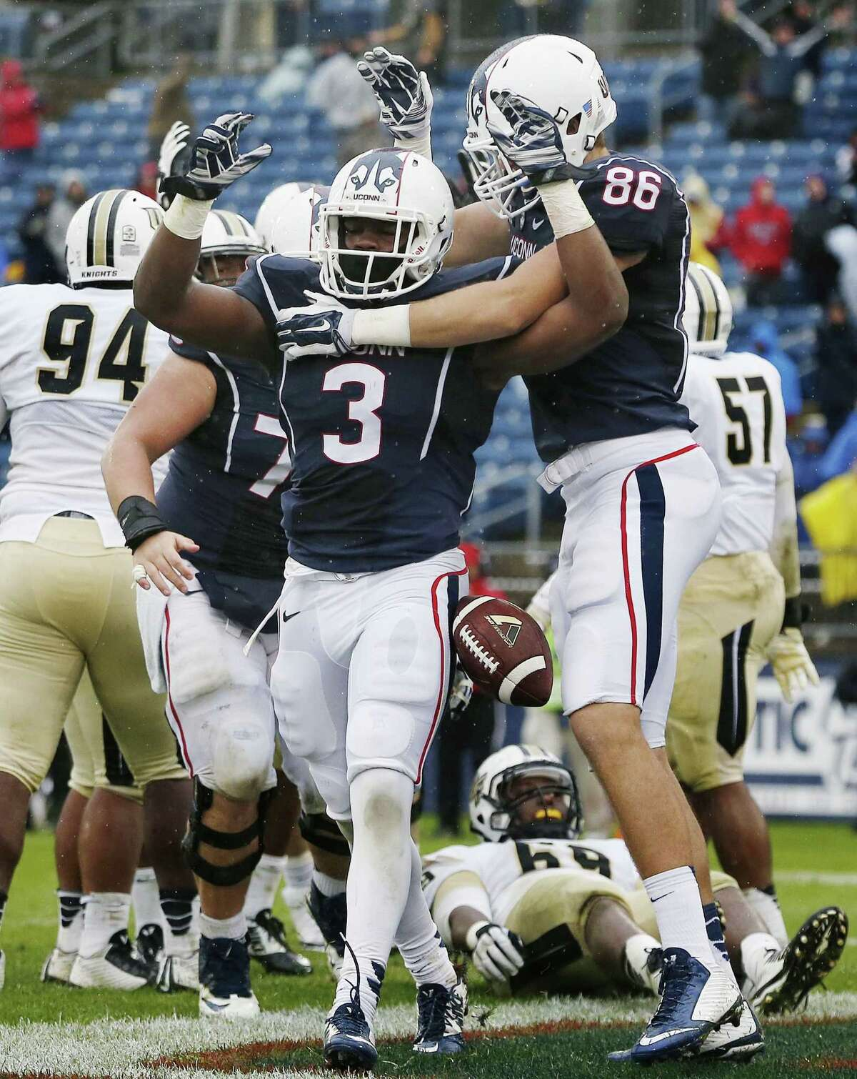 UConn running back Ron Johnson celebrates his touchdown with teammate Alec Bloom (86) in the fourth quarter of the Huskies' 37-29 win on Saturday afternoon at Rentschler Field in East Hartford.