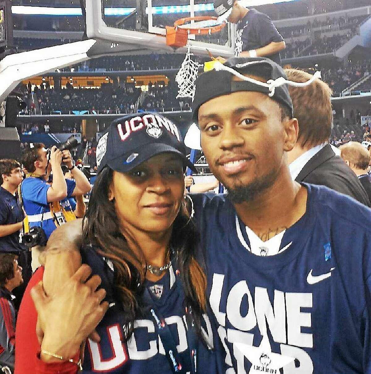 UConn senior Ryan Boatright and his mother, Tanesha, celebrate the Huskies' national championship last April in Arlington, Texas.