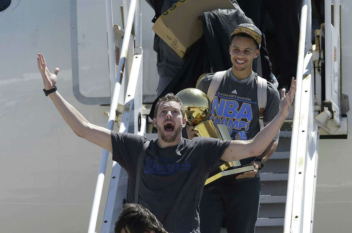 The Golden State Warriors traded David Lee, here with trophy-carrying Stephen Curry, to the Boston Celtics for Gerald Wallace.