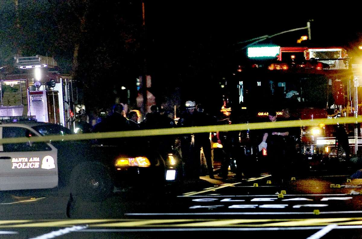 Police and emergency respoders at the scene where three teenage girls trick-or-treating in costume were hit by a vehicle and killed while walking across a Southern California intersection in Santa Ana Calif., Friday Oct. 31, 2014. Santa Ana police Cpl. Anthony Bertagna says the girls were hit while in a crosswalk near an elementary school early Friday evening. (AP Photo/The Orange County Register, Paul Rodriguez)