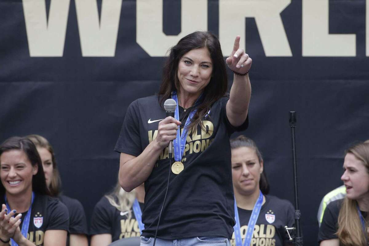 U.S. women's soccer team goalie Hope Solo, center, points to the crowd while celebrating the team's World Cup championship during a public celebration on Tuesday in Los Angeles.