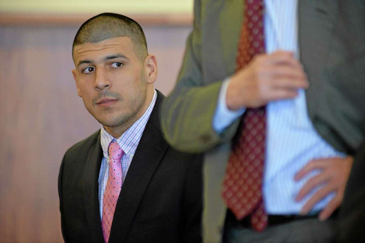 Aaron Hernandez looks on during proceedings in Fall River superior court Monday in Fall River, Mass.