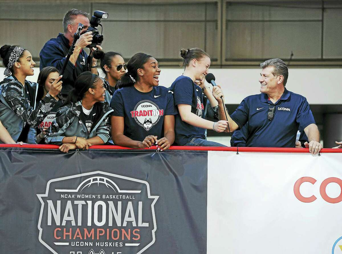 Members of the UConn women's basketball team laugh as head coach Geno Auriemma, right, puts Ansonia's Tierney Lawlor on the spot during a celebration of the program's 10th national championship on April 12 in Hartford.