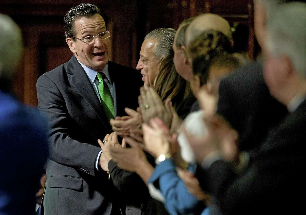Gov. Dannel P. Malloy arrives in House Chambers to deliver the State of State address at the State Capitol in Hartford, Conn., Wednesday, Feb. 8, 2012. (AP Photo/Jessica Hill)
