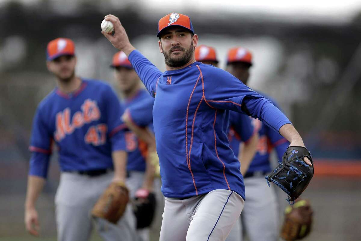New York Mets pitcher Matt Harvey throws to first during spring training baseball practice Saturday, Feb. 21, 2015, in Port St. Lucie, Fla. (AP Photo/Jeff Roberson)