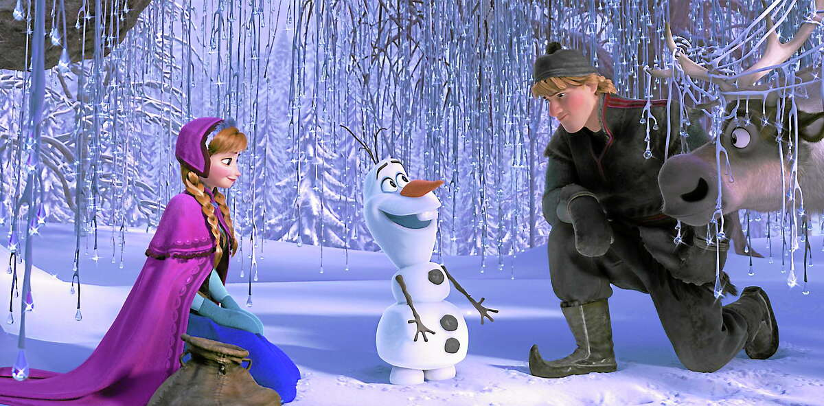 """From left, Anna, voiced by Kristen Bell, Olaf, voiced by Josh Gad, and Kristoff, voiced by Jonathan Groff in a scene from """"Frozen."""" (AP photo)"""