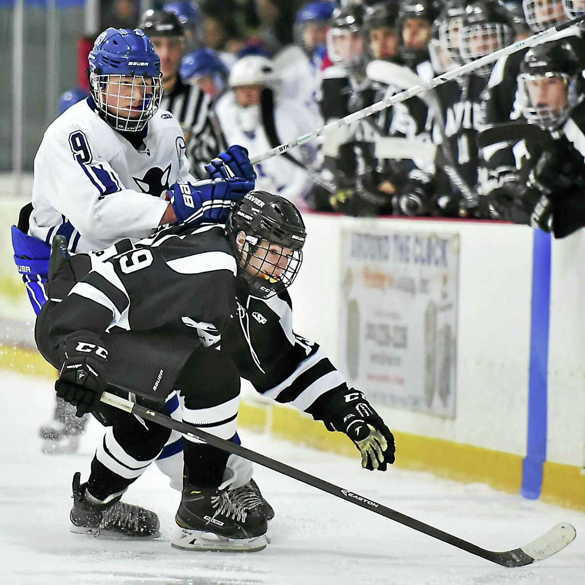 (Catherine Avalone - New Haven Register) Xavier's Jacob Monroe and West Haven's Hunter Cole in pursuit of the puck Wednesday, December 30, 2015, at the West Haven High School Christmas Tournament at the Edward L. Bennett Rink. Xavier won, 5-2.