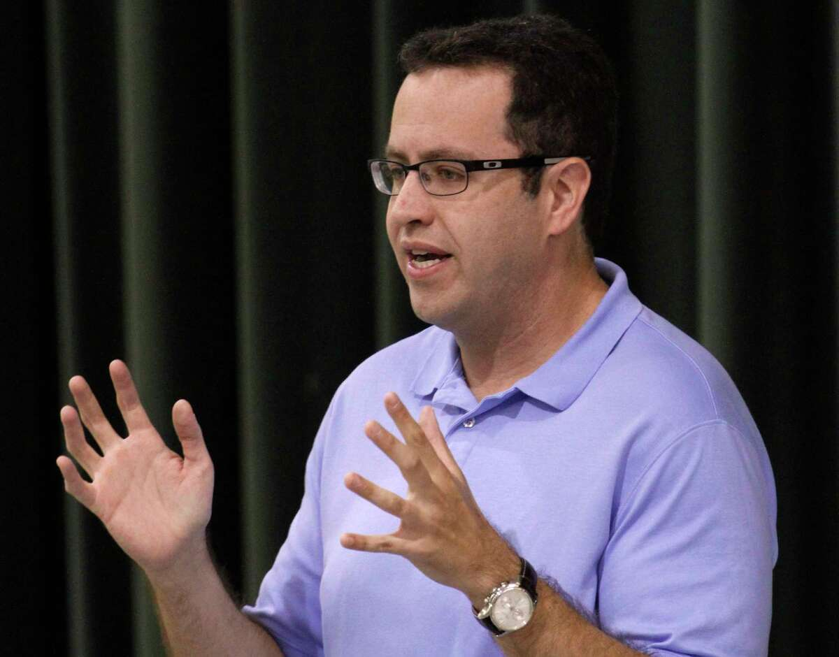 FILE - In this Sept. 18, 2013 file photo, longtime Subway front man Jared Fogle speaks to students about healthy eating and exercise at Battle Academy in downtown Chattanooga, Tenn. FBI agents and Indiana State Police on Tuesday, July 7, 2015 raided Fogle's Zionsville, Ind. home and have removed electronics from the property. (Dan Henry/Chattanooga Times Free Press via AP) THE DAILY CITIZEN OUT; NOOGA.COM OUT; CLEVELAND DAILY BANNER OUT; LOCAL INTERNET OUT; MANDATORY CREDIT