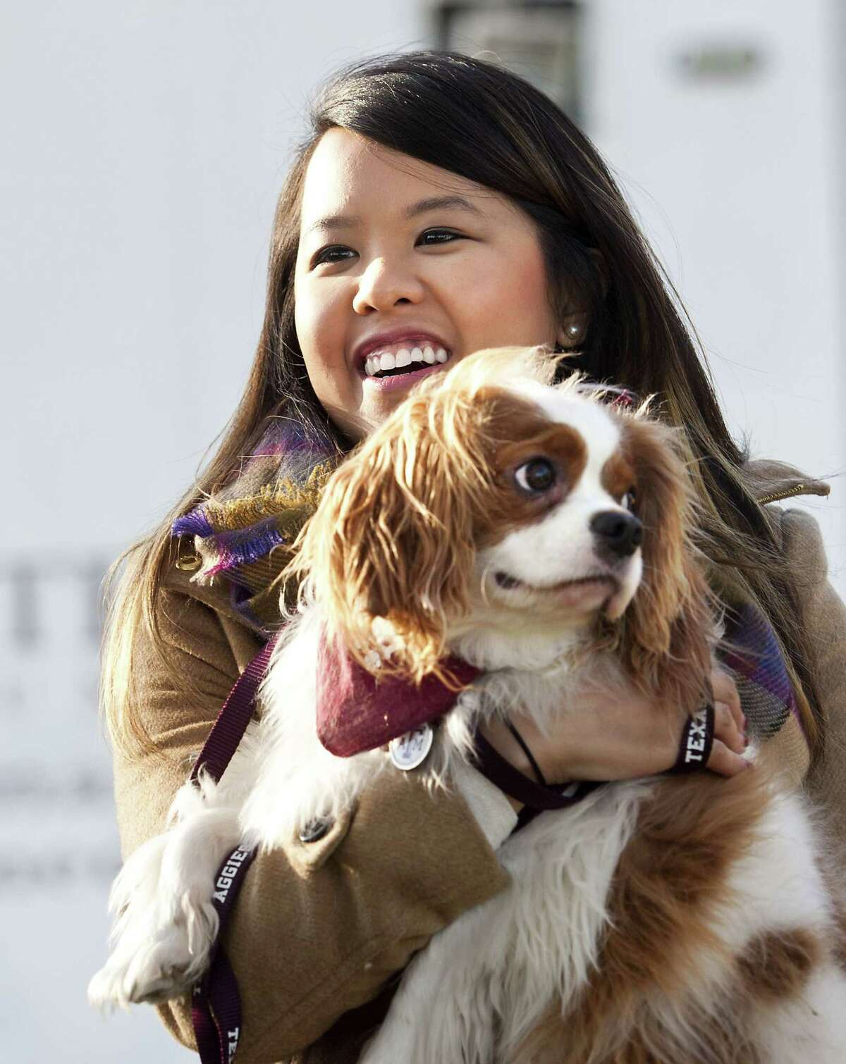 Nina Pham holds up her dog Bentley, at Hensley Field in Grand Prairie, Texas, Nov. 1, 2014. Pham, who recovered from Ebola, and the King Charles Spaniel were reunited privately on Saturday in a vacant residence where officers once lived at a decommissioned naval air base, where he was quarantined for 21 days.
