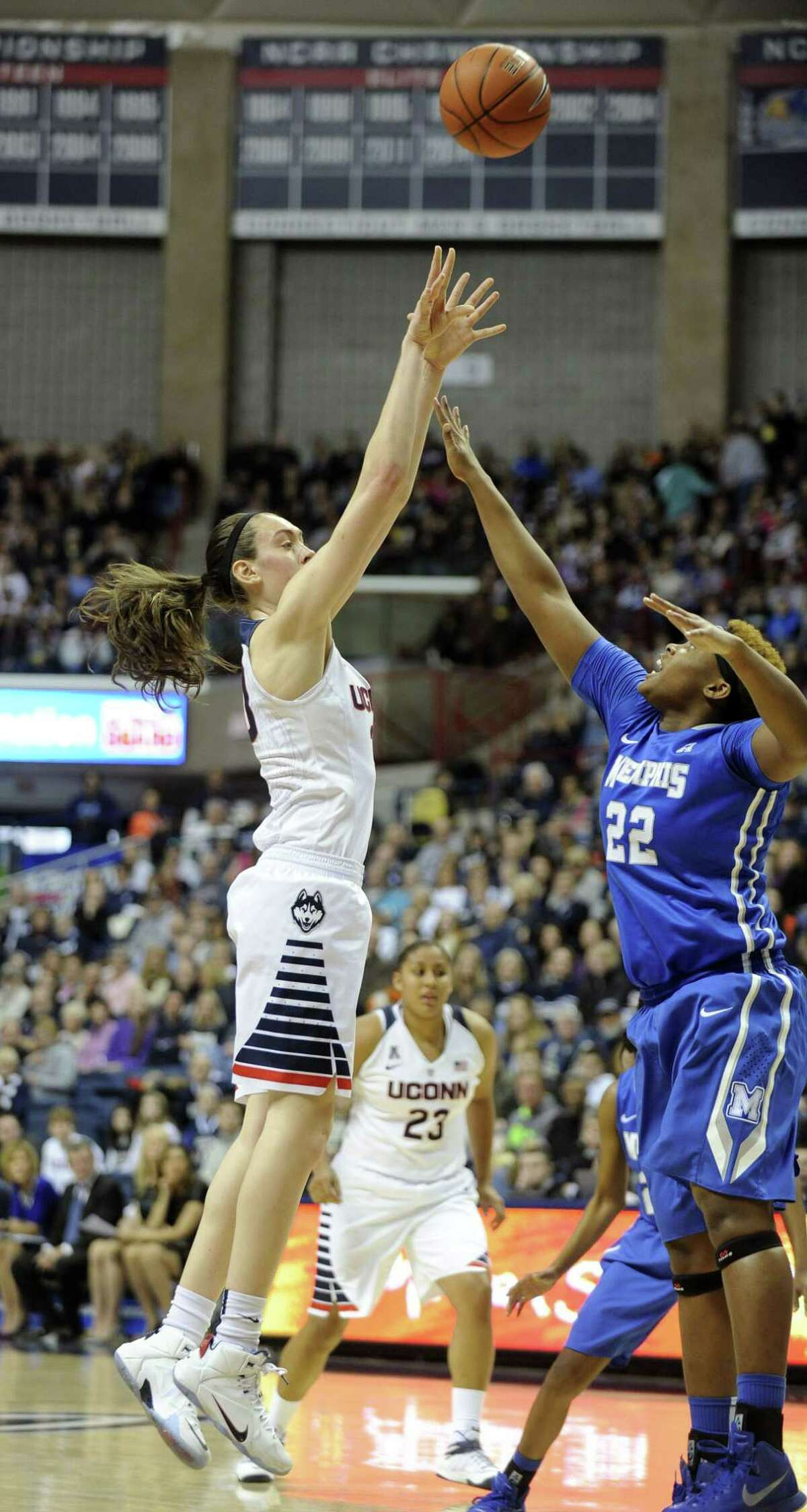 Connecticut's Breanna Stewart (30) shoots over Memphis' Brianna Wright (22) during the first half of an NCAA college basketball game in Storrs, Conn., on Saturday, Feb. 28, 2015. (AP Photo/Fred Beckham)