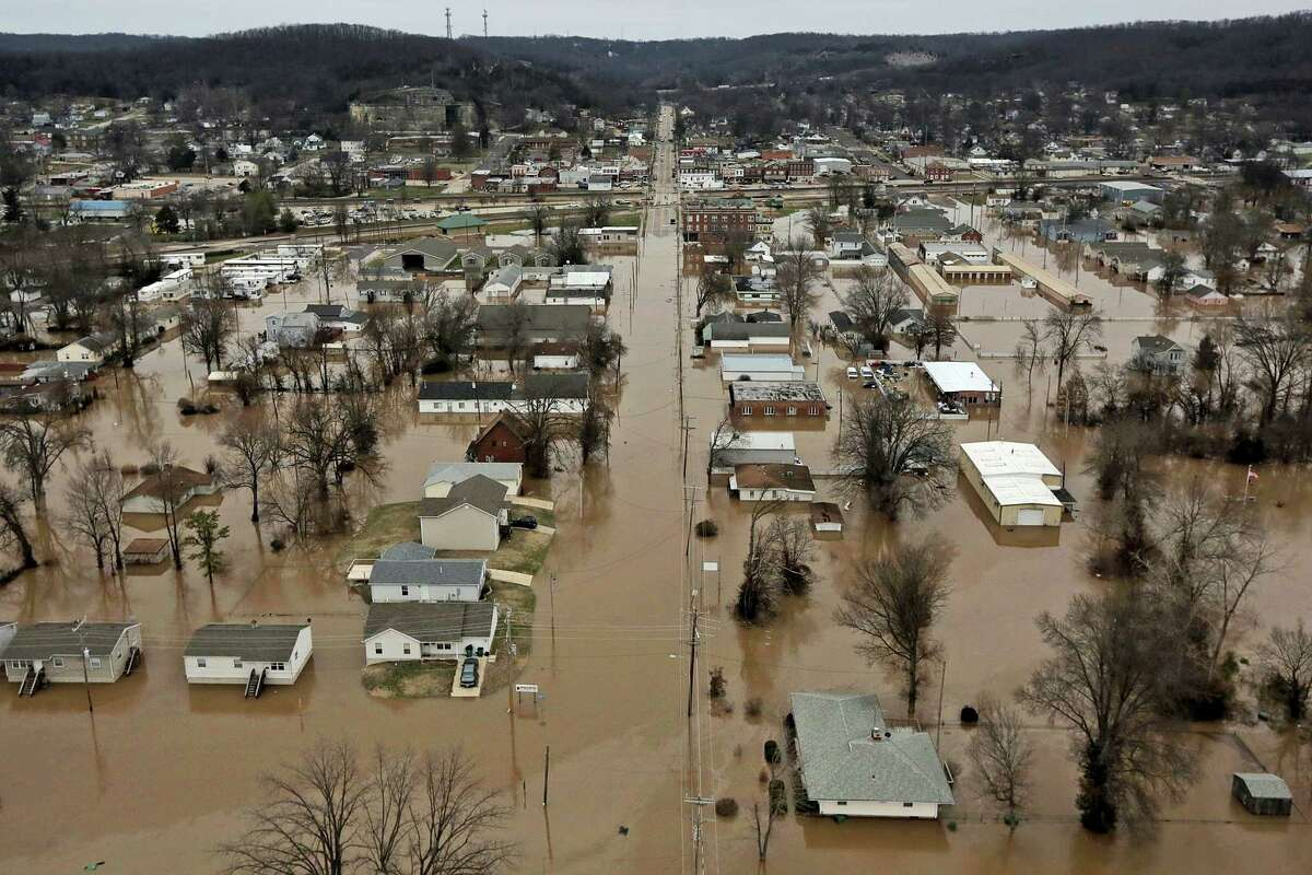 This photo shows a northern view of 1st Street where homes were flooded on Tuesday in Pacific, Mo. Torrential rains over the past several days pushed already swollen rivers and streams to virtually unheard-of heights in parts of Missouri and Illinois.
