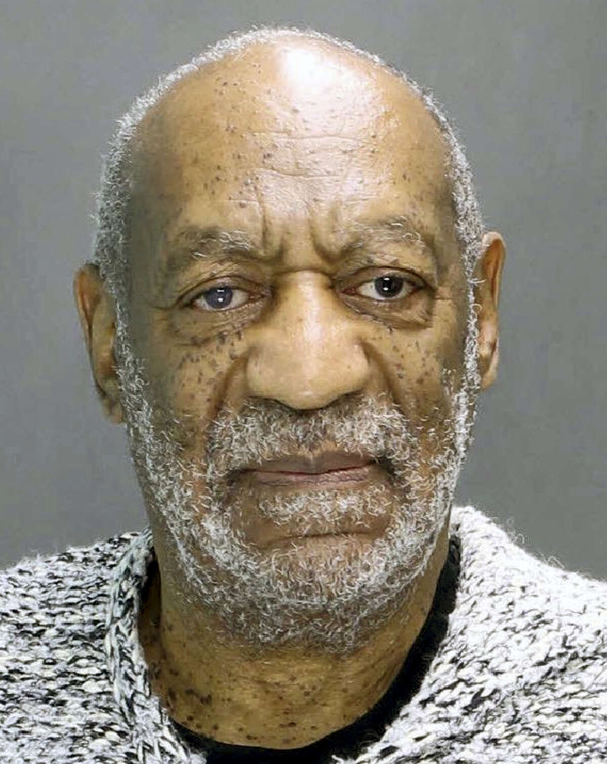 This booking photograph released by the Montgomery County District Attorney's Office shows Bill Cosby, who was arrested and charged Wednesday, Dec. 30, 2015, in district court in Elkins Park, Pa., with aggravated indecent assault. Cosby is accused of drugging and sexually assaulting a woman at his home in January 2004.