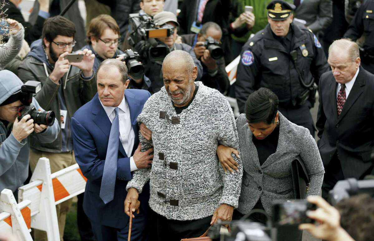Bill Cosby arrives at court to face a felony charge of aggravated indecent assault Wednesday, Dec. 30, 2015, in Elkins Park, Pa. Cosby was charged Wednesday with drugging and sexually assaulting a woman at his home 12 years ago.