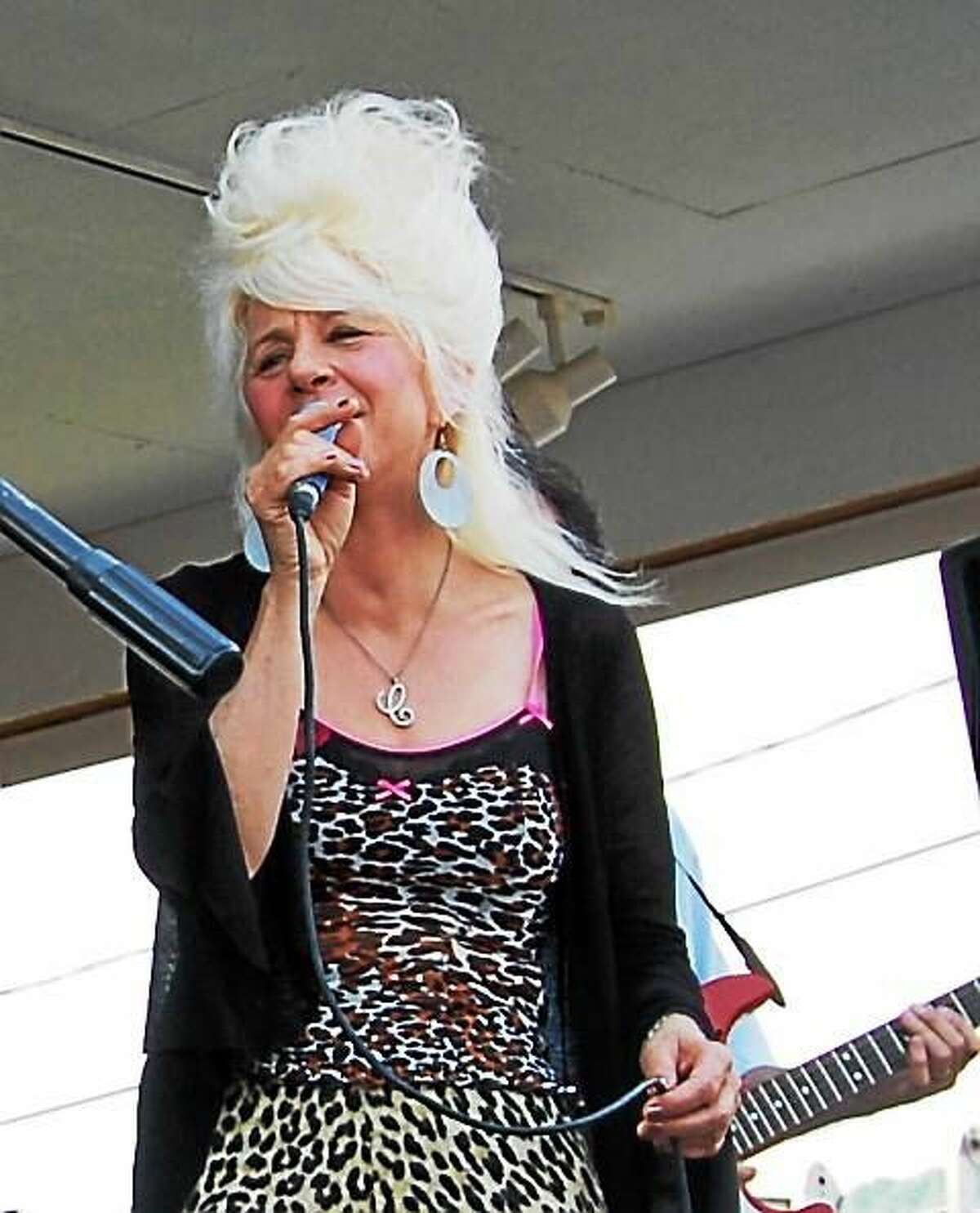 Photo by Dom Forcella Christine Ohlman, the Beehive Queen, performs at Bridge Street Live in Collinsville July 11.