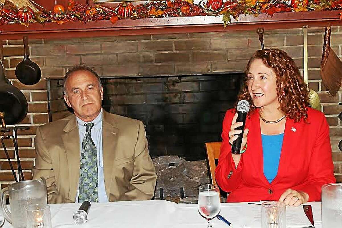 5th District Congresswoman Elizabeth Esty speaks at a candidatesí forum in Woodbury Tuesday night as her Republican opponent, Mark Greenberg, looks on.