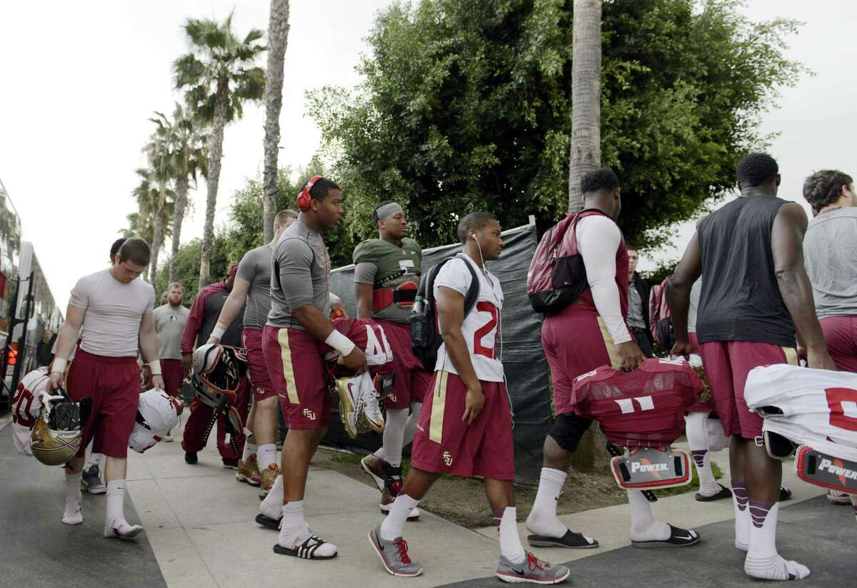 Florida State players walk to the fields for practice on Tuesday in Carson, Calif.