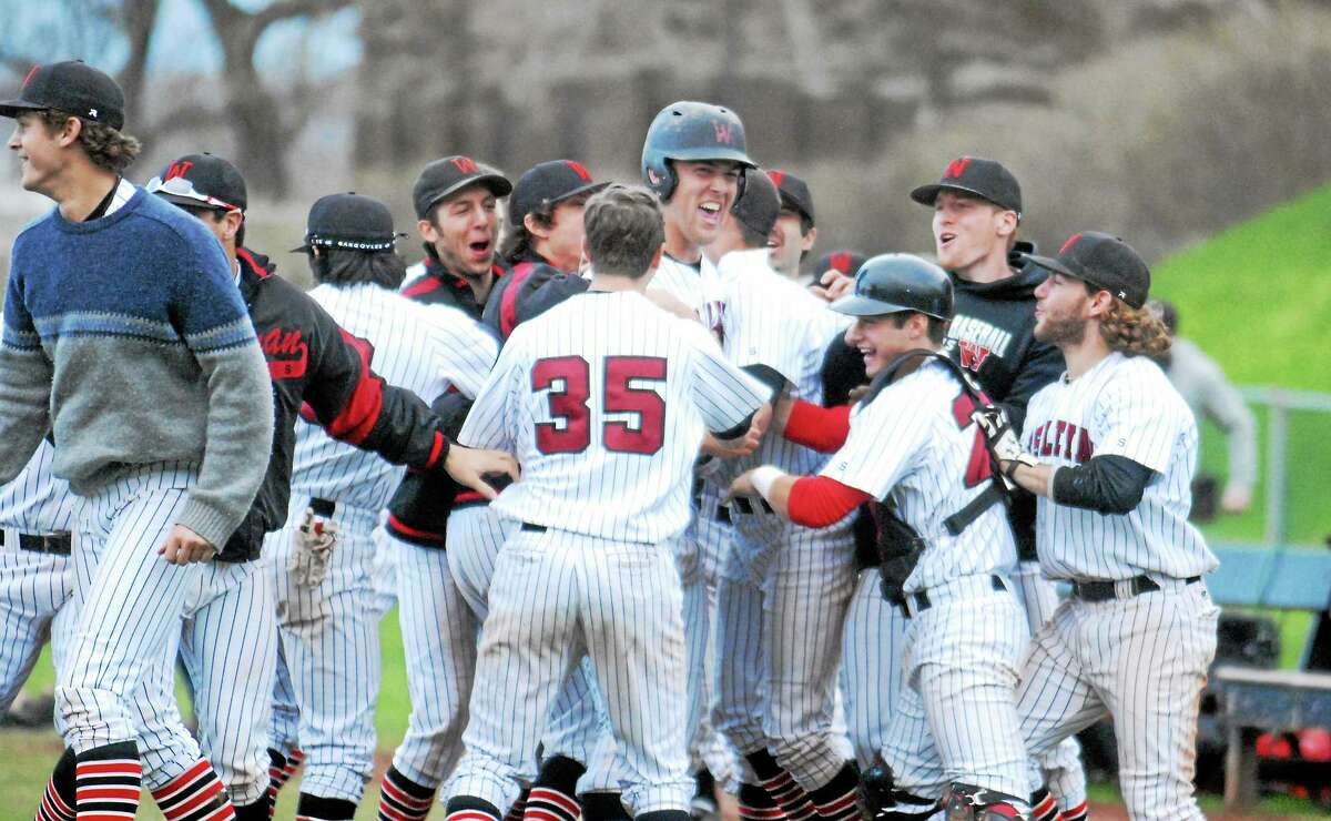 Sam Goodwin-Boyd and his Wesleyan teammates celebrate after Goodwin-Boyd's clutch seventh inning home run ties Amherst in the Little Three championship.