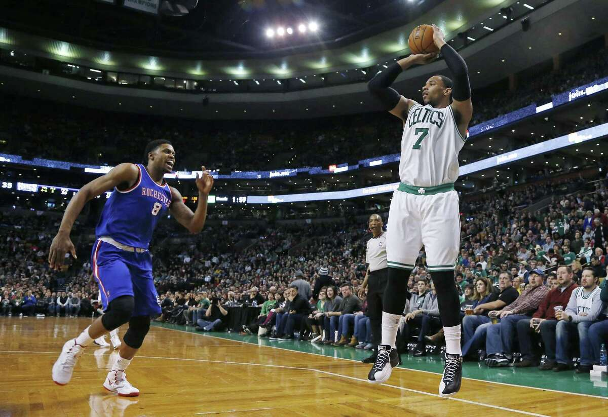 Celtics forward Jared Sullinger shoots a jumper before Sacramento Kings forward Rudy Gay can defend him in the first half of Wednesday's game in Boston.