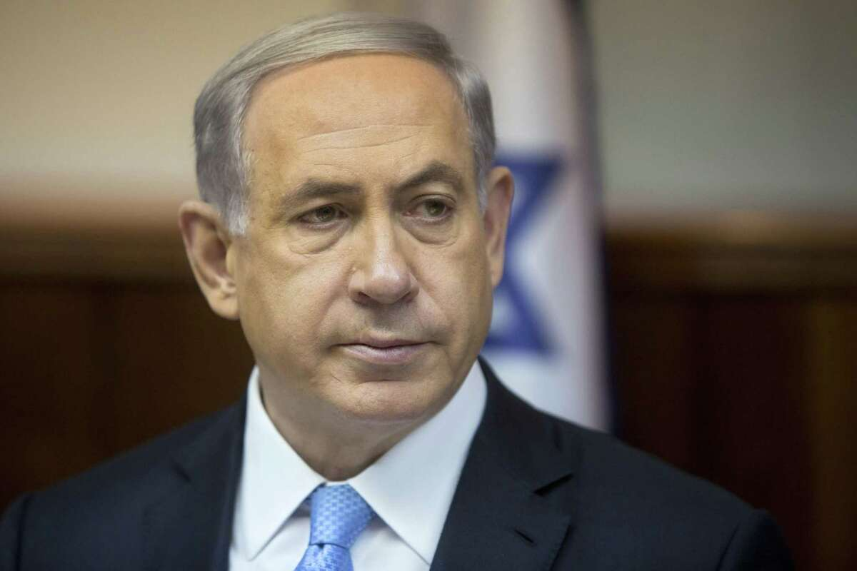 In this Feb. 8, 2015 file photo, Israeli Prime Minister Benjamin Netanyahu attends the weekly cabinet meeting in his Jerusalem office. Jewish House Democrats personally offered Israeli Prime Minister Benjamin Netanyahu a chance to lower the political temperature after he accepted a Republican invitation to speak to Congress next week on Iran _ a less provocative, closed-door session. Netanyahu turned them down, frustrating members of President Barack Obama's party caught between the White House and the Israeli leader. (AP Photo/Sebastian Scheiner, File)
