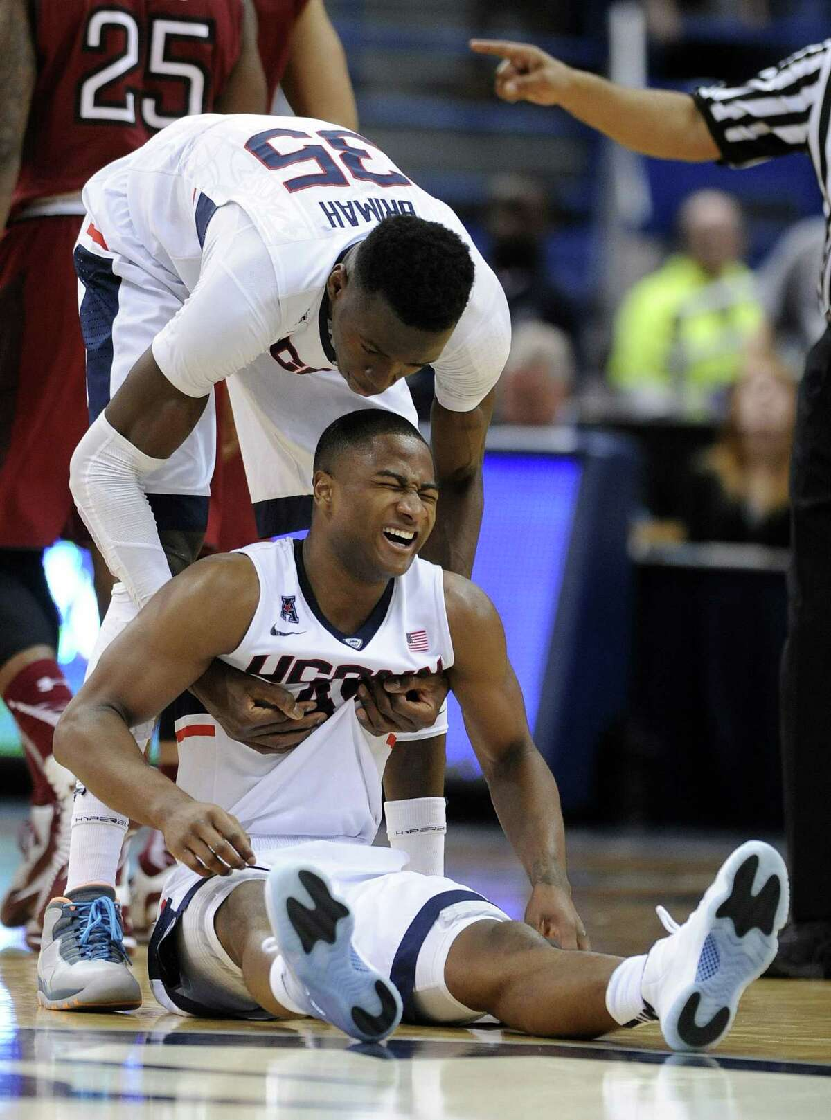 UConn's Amida Brimah, top, and Rodney Purvis react during the second half of the Huskies' 57-53 overtime loss to Temple on Wednesday in Hartford.