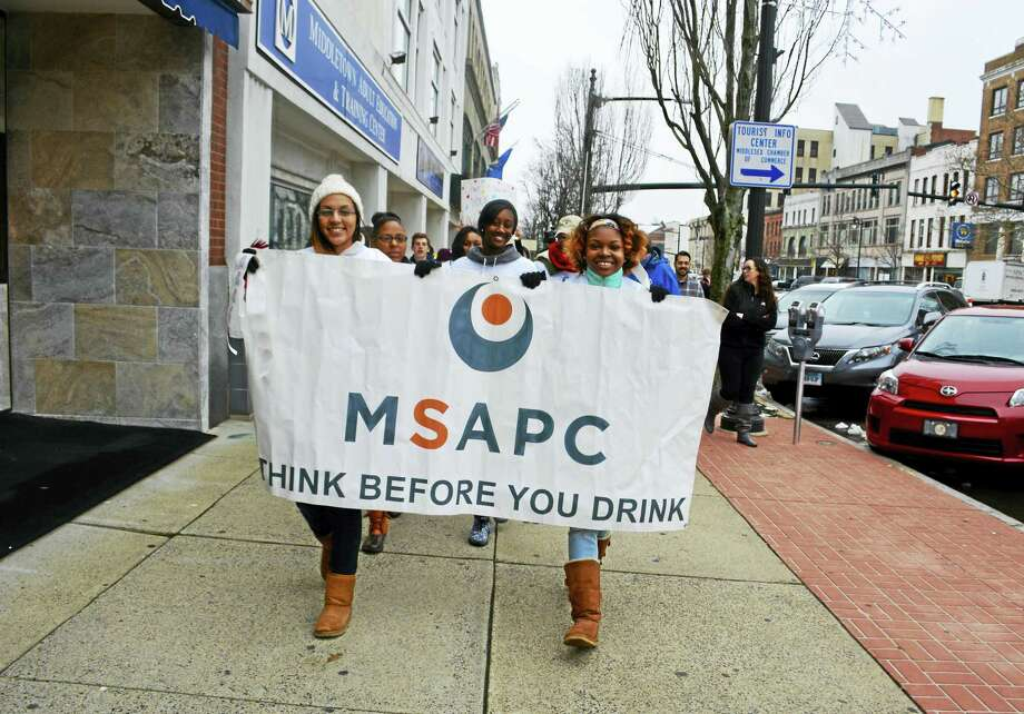The Middletown Substances Abuse Prevention Council held its 11th annual White Out event on Wednesday at noon. The walk began at the Chamber of Commerce and continued through downtown Main Street. Photo: Sam Norton — The Middletown Press