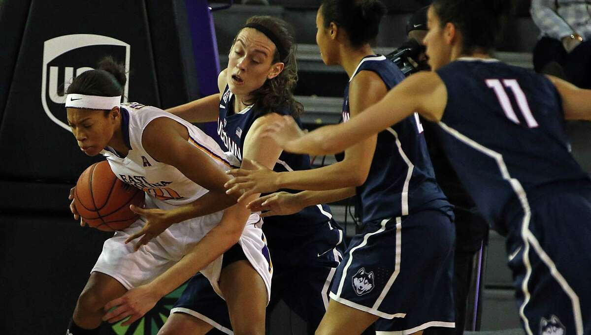 East Carolina's Abria Trice, left, battles with UConn's Breanna Stewart during the second half of the Huskies' 89-38 win on Wednesday in Greenville, N.C.