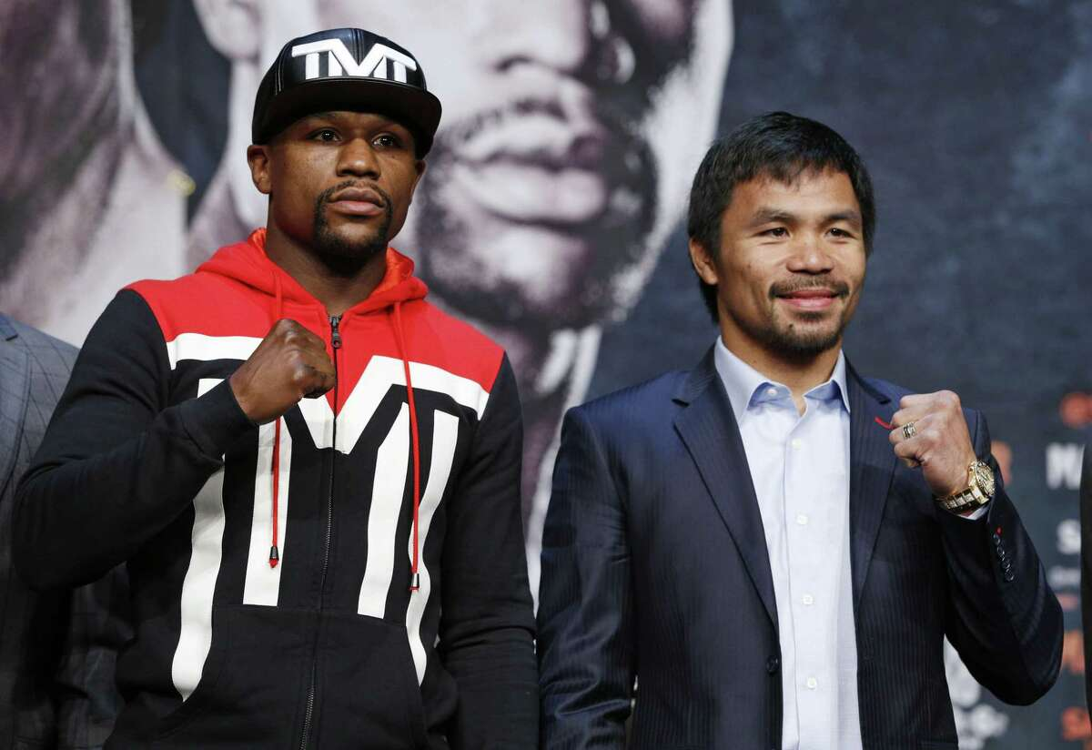 Boxers Floyd Mayweather Jr., left, and Manny Pacquiao pose during a press conference Wednesday in Las Vegas.