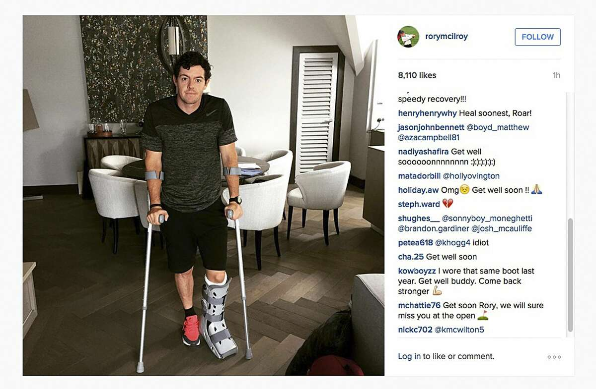 """In this image released Monday July 6, 2015 by world number one golfer Rory Mcilroy shows him as he poses on crutches and with his left leg in a medical support. McIlroy ruptured a ligament in his left ankle while playing soccer less than two weeks before the start of his British Open title defense. The Northern Irish golfer gave no indication how long he would be out in the announcement Monday on his Instagram account, only saying that he is """"working hard to get back as soon as I can."""""""