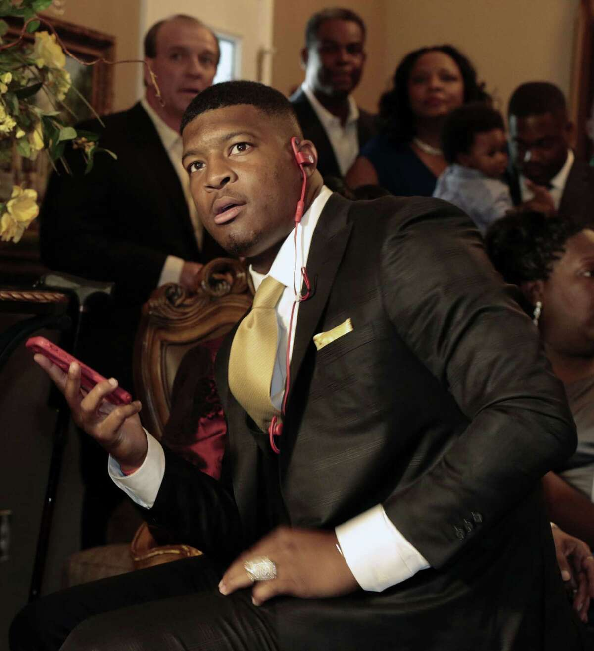 Jameis Winston takes the call from Tampa Bay Buccaneers Thursday in Bessemer, Ala. The Bucs put an end to months of speculation by selecting the talented-but-troubled signal caller, who won the Heisman Trophy in 2013.