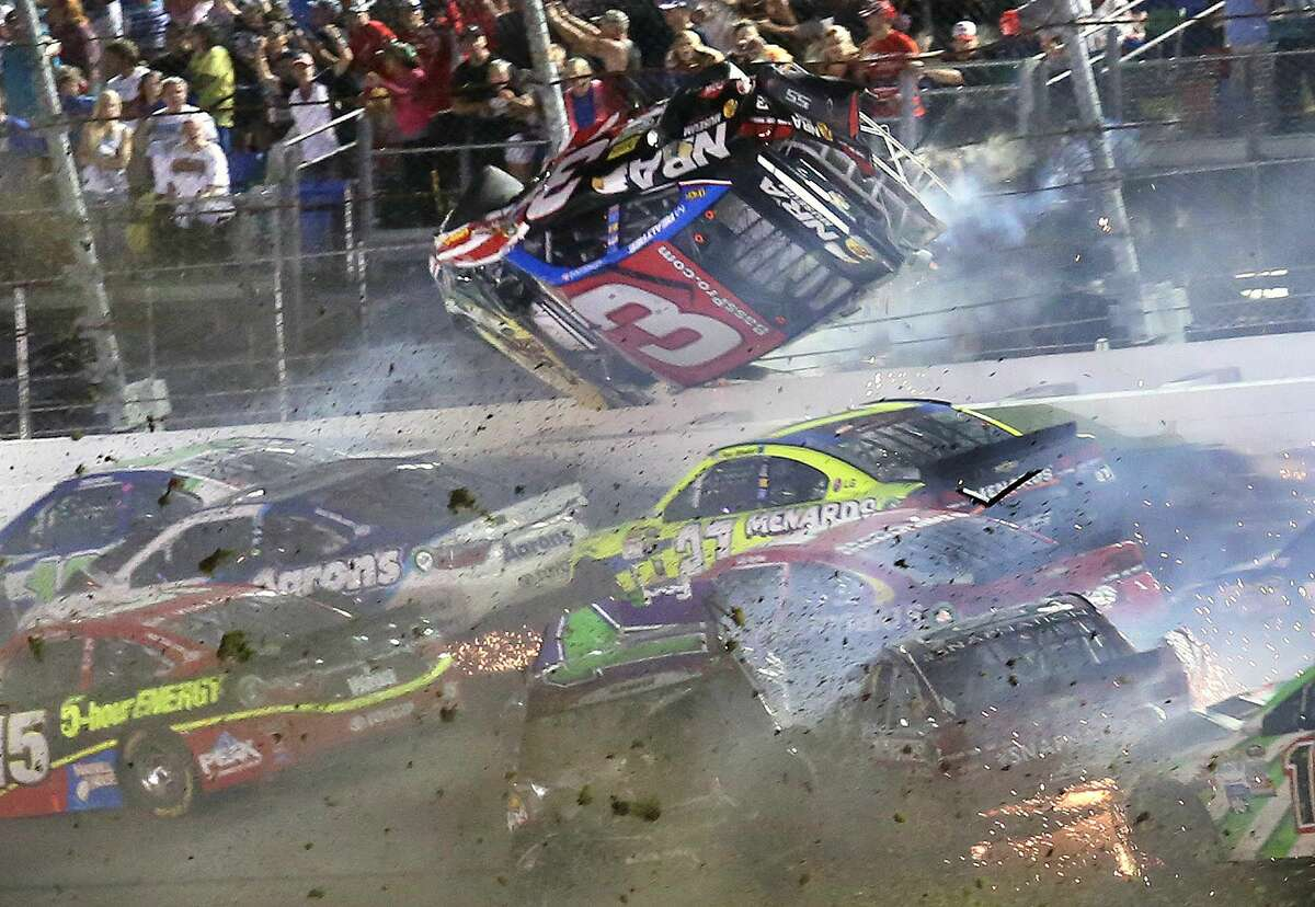 Austin Dillon (3) goes airborne as he was involved in a multi-car crash on the final lap of the NASCAR race at Daytona International Speedway early Monday morning.