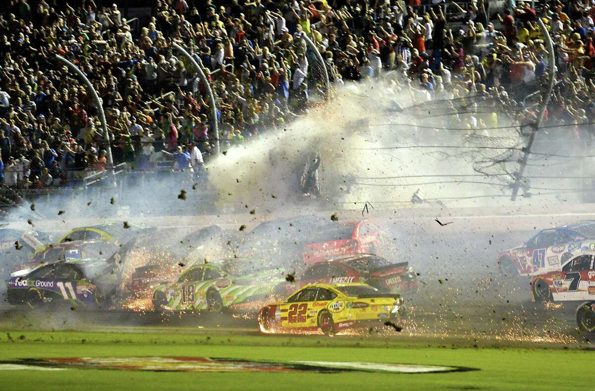 Austin Dillon (3) goes airborne and hits the catch fence on Monday at Daytona.