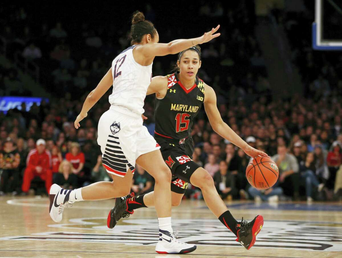 UConn guard Saniya Chong defends Maryland guard Chloe Pavlech during the second half of the Huskies' 83-73 win Monday night at MSG.