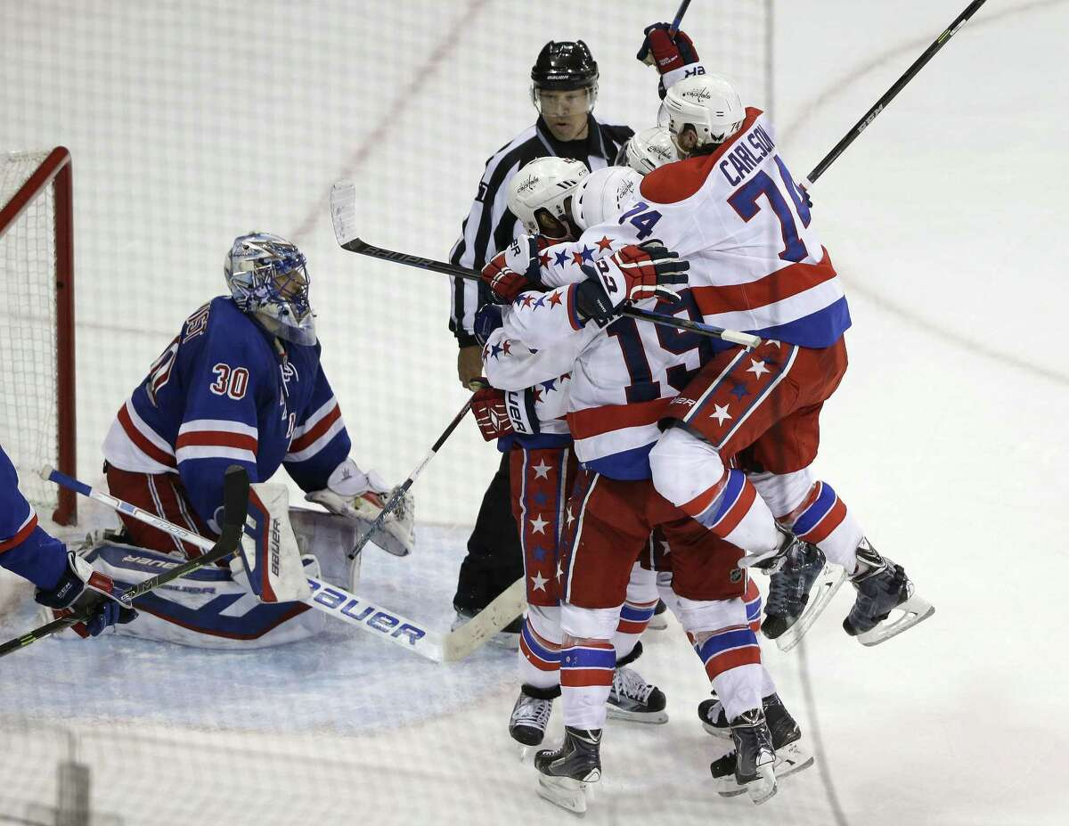 The Capitals celebrate a goal by left wing Alex Ovechkin during Thursday's game against the Rangers.