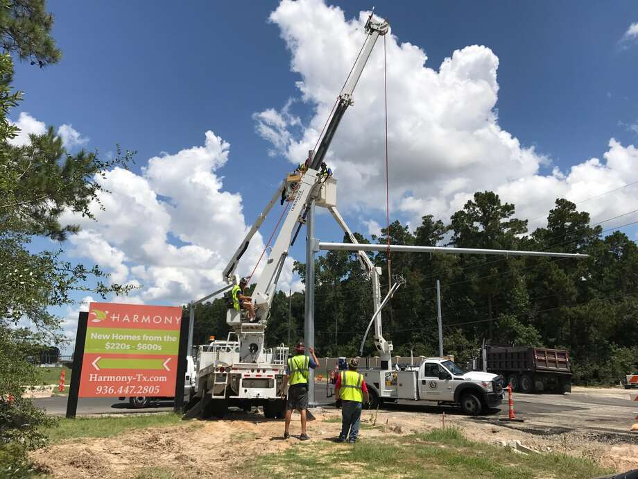 County construction workers install a new traffic signal at the corner of Birnham Woods at Waterbend Cove. The Conroe Independent School District together with the County are stepping up safety protocols for the start of the 2017-2018 school year. Photo: Michelle Iracheta