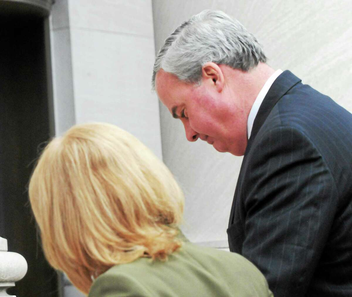 Former Connecticut Governor John G. Rowland, right, arrives at the Federal Courthouse in New Haven.