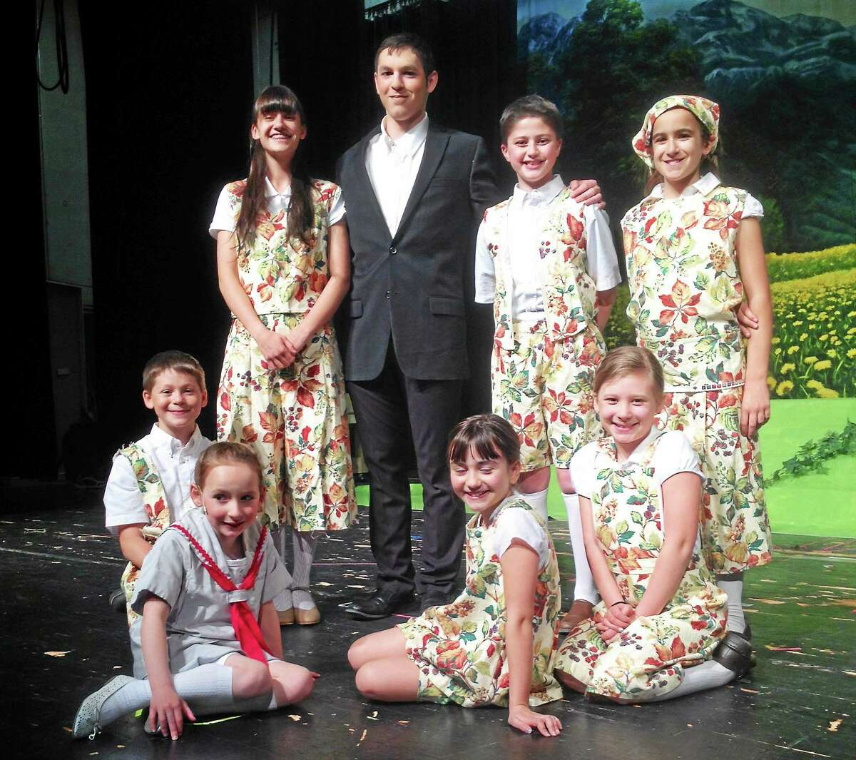"""East Hampton High School 11th-grader Sam Laraia plays Capt. von Trapp in """"The Sound of Music."""" The children staging the production, ages 5 to 15, have looked up to him for direction as a sort of father during rehearsals, he says."""