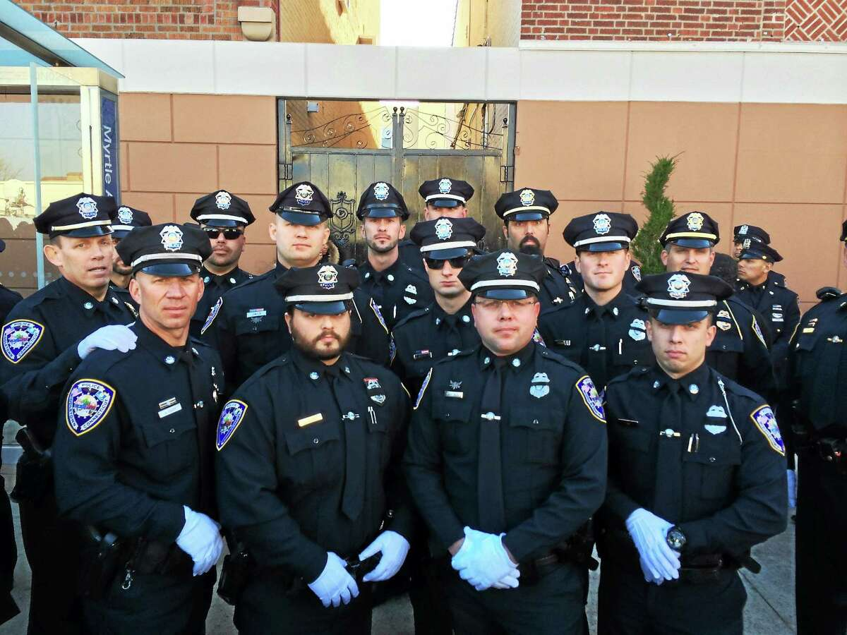 Middletown police personnel traveled to New York recently, shown here in the city, for the funeral of NYC Officer Rafael Ramos.
