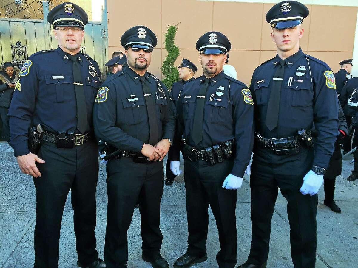 From left are Detective Sgt. Kevin A. VanderSloot, Officers David Ellison, Peter Petraroia and John Carlson of the Cromwell Police Department.