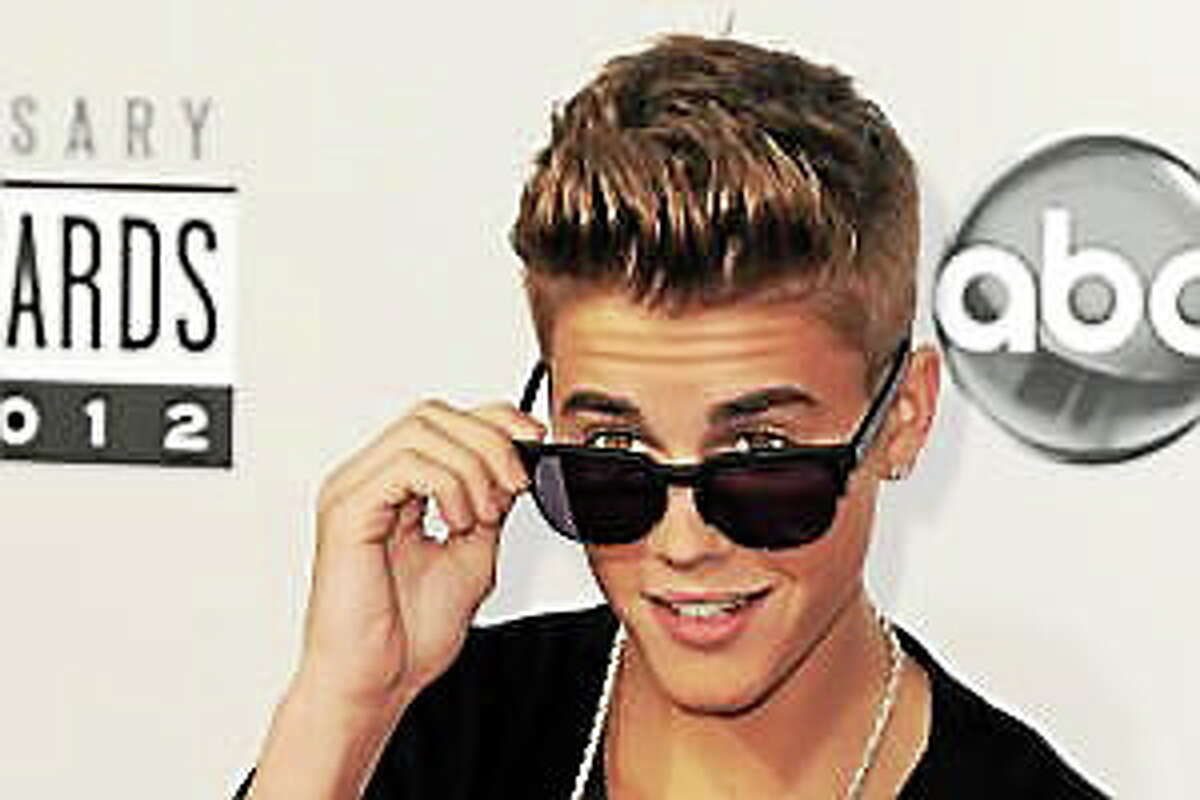 In this Nov. 18, 2012, file photo, Justin Bieber arrives at the 40th Anniversary American Music Awards in Los Angeles.