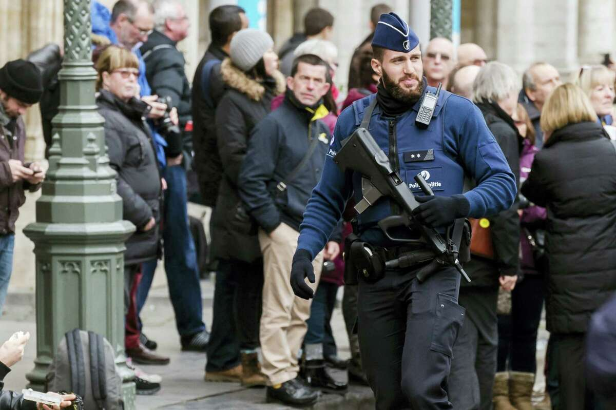 An armed police man patrols at the Grand Place in Brussels Tuesday.
