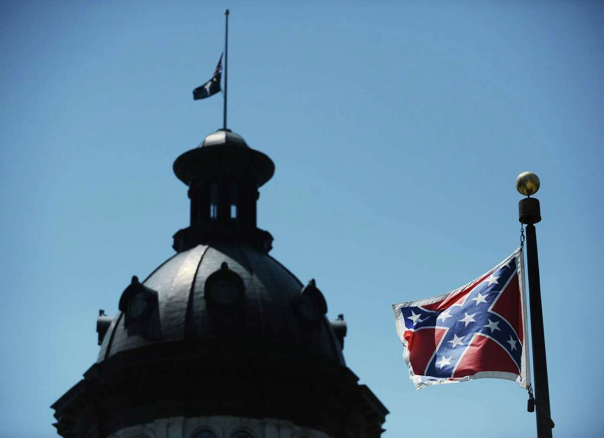 In this June 19, 2015 photo, the Confederate flag flies near the South Carolina Statehouse in Columbia, S.C. The General Assembly returns July 6, 2015, to discuss what to do with the rebel flag that has flown over some part of the Statehouse for more than 50 years.