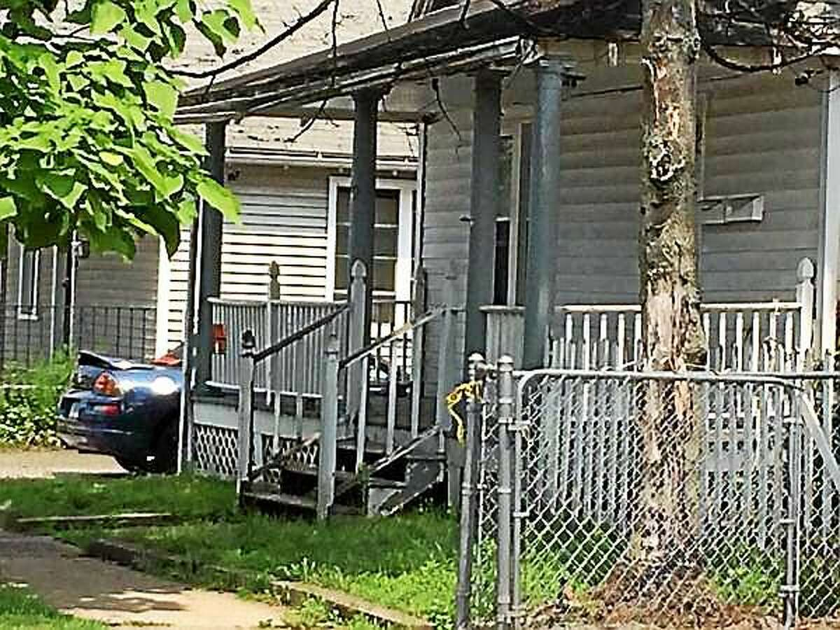 Police executed a search and seizure warrant at 59 Front Ave. Monday in connection with the explosion and body found in Hamden over the weekend.