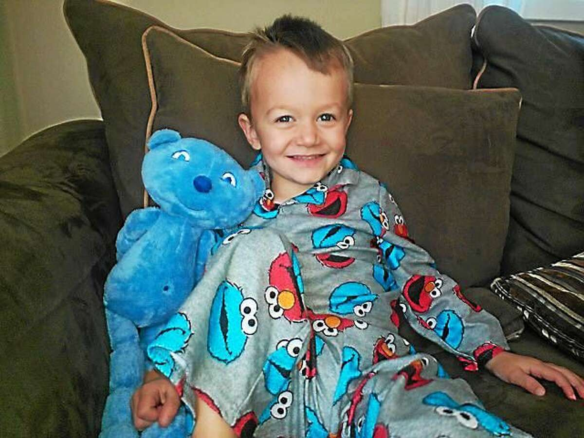 Nar Scaia, 3, is shown with Iggy Bear on treatment day, which helps the preschool get through his weekly infusion.