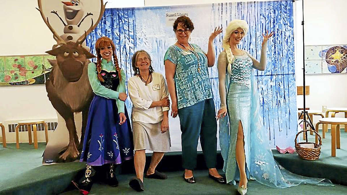 """Children's programs celebrate the season this week at Russell Library in Middletown. Here, Elsa, Anna, Laura and Ann delight young ones with the Snow sisters from """"Frozen"""" last year."""