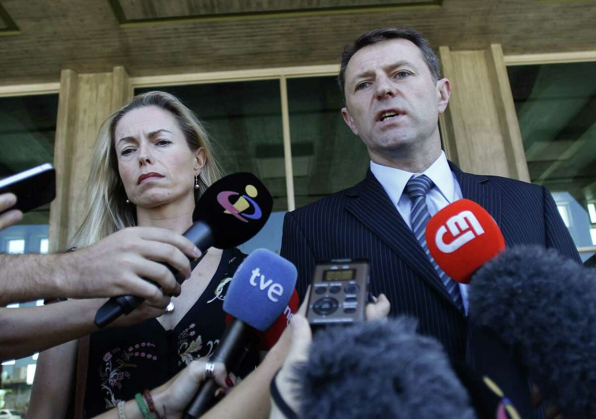 FILE - This is a Tuesday, July 8, 2014 file photo of Kate McCann, left, and Gerry McCann, the parents of missing British girl Madeleine McCann, as they talk to the media outside a court in Lisbon. The McCanns have won 500,000 euros ($549,000) in a libel action against a former Portuguese detective who published a book alleging they were involved in their daughter's disappearance. The McCanns were seeking 1.2 million euros in damages from Goncalo Amaral, who was part of the police investigation into Madeleine's disappearance from a vacation home in Portugal's Algarve region in May 2007, days before her fourth birthday. (AP Photo/Francisco Seco, File)