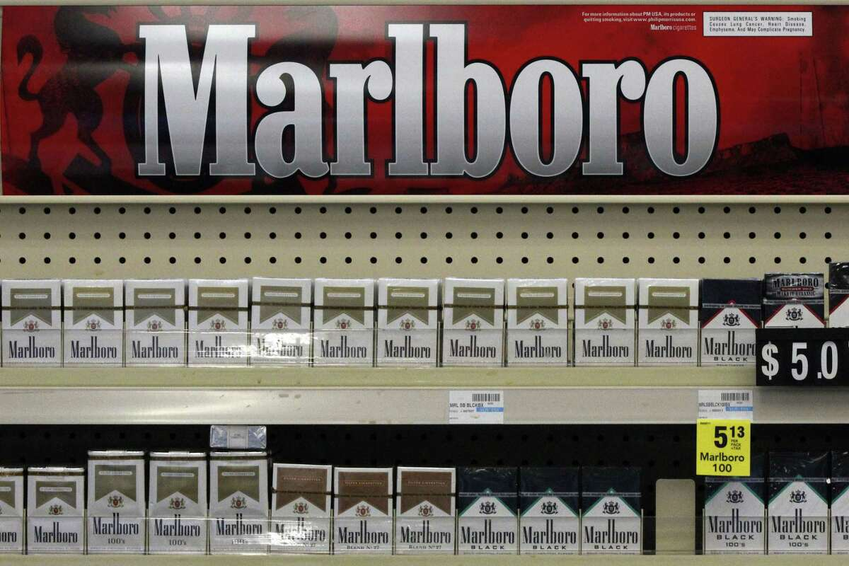 FILE - In this July 17, 2013 file photo, cigarettes are on display at a store in Pittsburgh. America's largest tobacco companies must inform consumers that cigarettes were designed to increase addiction, but not that they lied to the public about the dangers of smoking, a federal appeals court ruled on Friday.